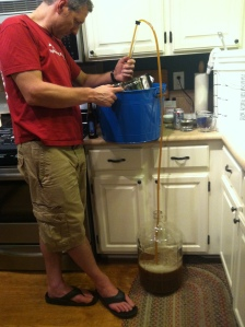 Siphoning the ale into the carboy.