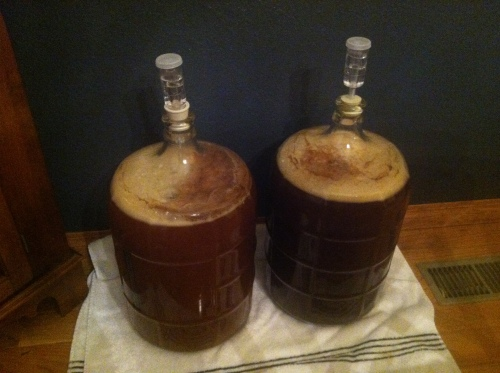 Amber and Brown Ale getting their ferment on. Basement temps have dropped, so these are now in the dining room. My wife loves that.