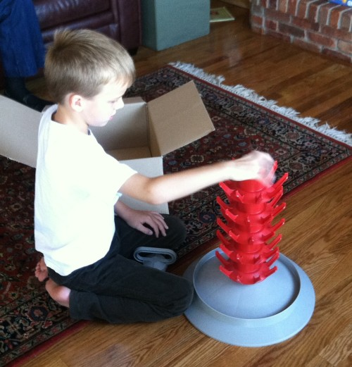 Henry assembles the bottle tree.