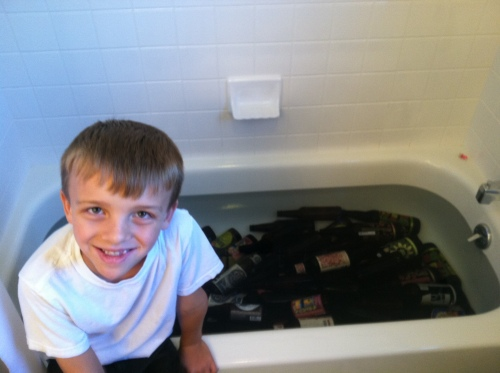 Henry, age 6, helps soak and remove labels for homebrew.